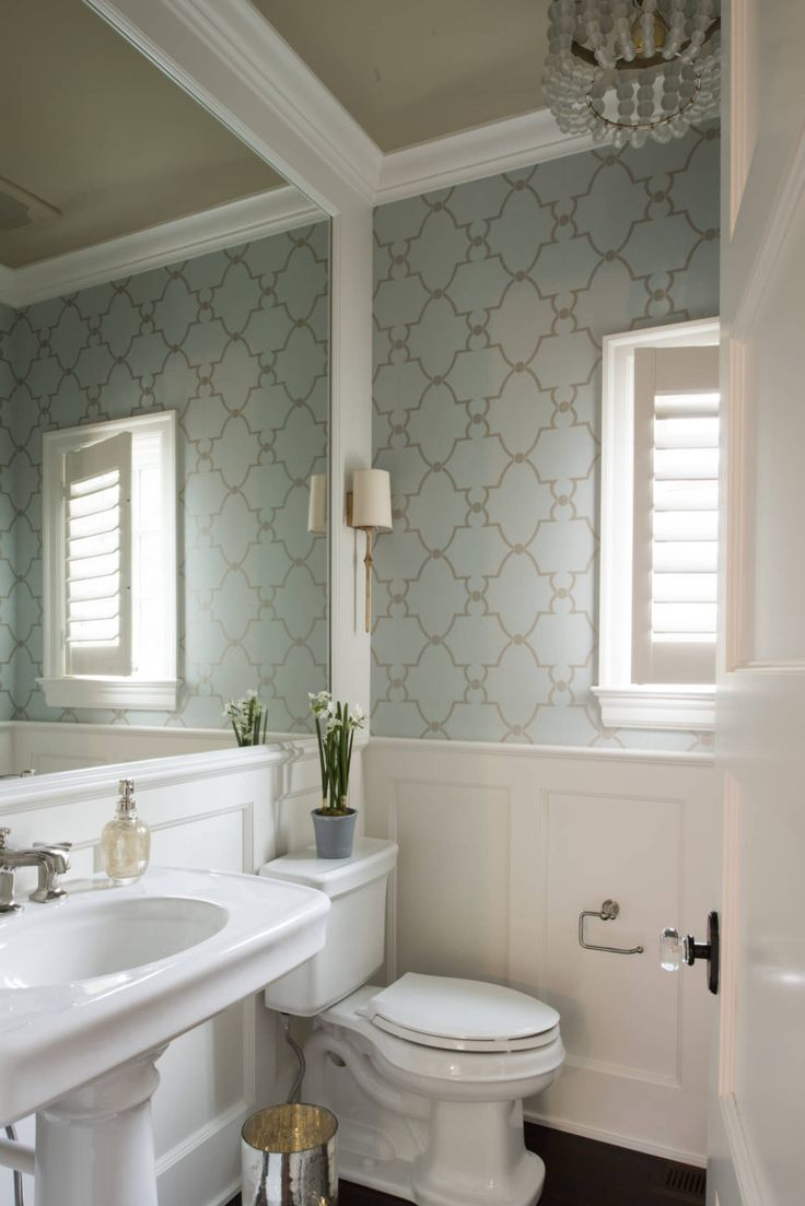 277 best wallpapered bathroom images on pinterest bathroom ideas pretty guest bathroom with white millwork large white framed mirror light blue wallpaper and elegant chandelier