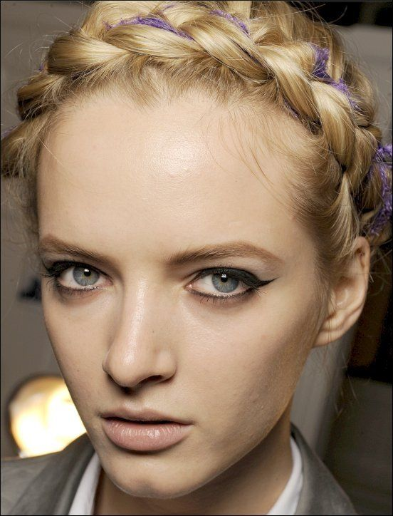 Plaited braids across the front of the head once again popular and teamed with dark eyeliner flicks keeps the look modern but classic at the same time. Most effective on those with narrow faces. Image from Squidoo.