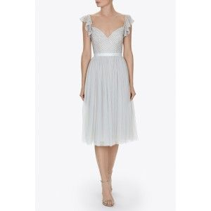 The Swan Dress has been designed as a move on from our best selling Coppelia Ballet Dress. The spearmint dress has a softly fitted bodice, embellished with tiny silver beads in a sim- ple mesh artwork. The bodice features delicate, adjustable straps and a grosgrain waistband. Circle cut frill panels on the sleeve add a delicate flutter, covering the top of the shoulders. The bodice extends into layers upon layers of frothy tulle, adding a beautifully elegant movement to the style. The skirt…