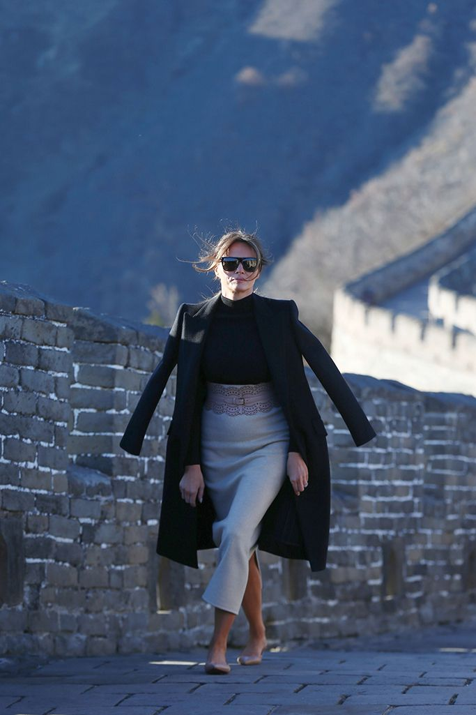 71fc0bc45763 Melania Trump wears a shirt and skirt from The Row with Christian Louboutin  flats at the Great Wall of China in November.