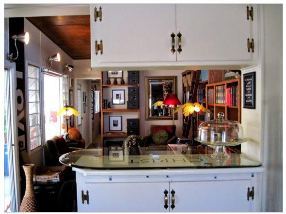 kitchen and living room after complete remodel of vintage mobile home