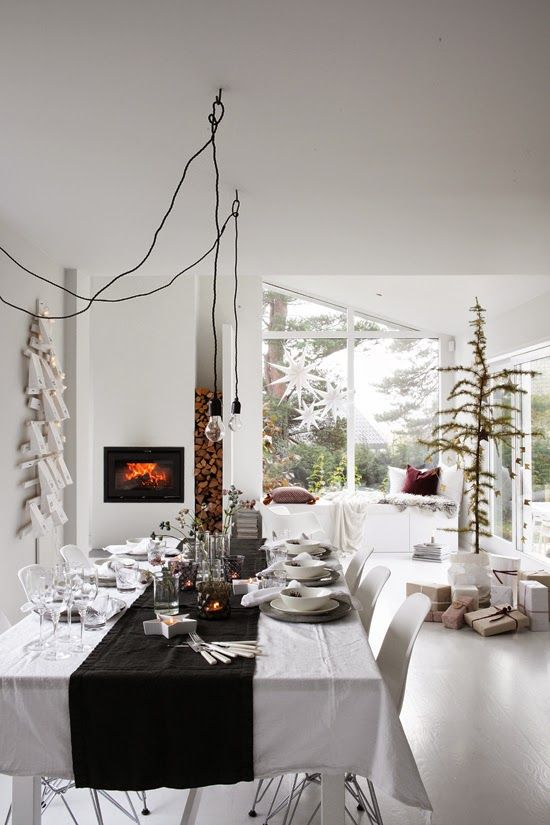 Spice up your holiday living room with these modern Christmas decor ideas, featuring neutrals, metallics, and natural touches.