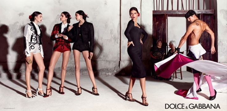 FacebookTwitterGoogle+Pinterest Channeling the spirit of the collection, the spring-summer 2015 campaign from Dolce & Gabbana focuses on the Spanish influence on Sicilian tradition with a cast led by Bianca Balti. Joined by Vittoria Ceretti, Irina Sharipova and Bianca Padilla; the girls take on Mediterranean style while posing next to grandmothers and matadors in a color palette of red, black and white. One half of Dolce & Gabbana, Domenico Dolce, photographed the new advertisements…