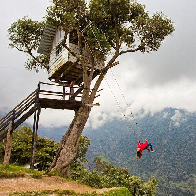 """Photo by Mike Theiss @ExtremeNature. ""Swing at the edge of the world"" located in Baños, Ecuador. The swings hangs from Casa Del Arbol treehouse and…"""
