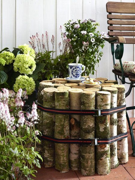 summer decorating ideas front porch - birch logs side table