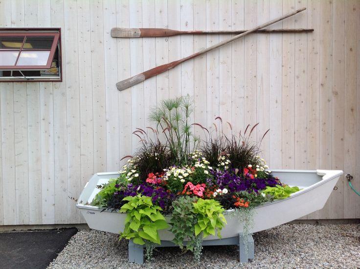 Boat planter! Love the plant combination.