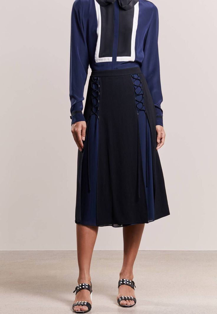 """KARL LAGERFELD. Pleated skirt - black. Fit:regular. Our model's height:Our model is 69.5 """" tall and is wearing size 10. Outer fabric material:70% acetate, 30% viscose. Care instructions:Dry clean only. Details:zip fastening,underskirt. ..."""