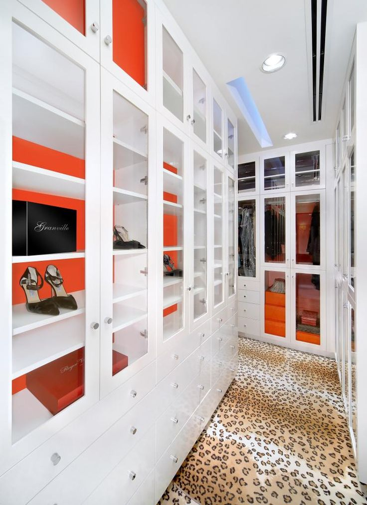 Glamorous Walk In Closet With Floor To Ceiling Built In Closet Cabinets.  White Built In Closet Cabinets Lined With Hermes Orange Paper And Leopard  Rug.