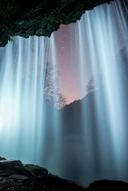 Behind the Curtain of Sgwd yr Eira Waterfall in Brecon Beacons National Park