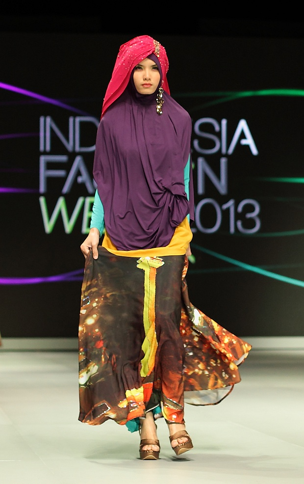 Indonesia's National Monument in Merdeka Square, Jakarta, is featured on this digitally printed design from Fenny Mustafa who stole the show with her creations in the Muslim wear parade at Indonesia Fashion Week in February 2013.