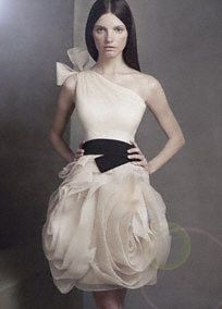 One-shoulder organza dress with hand-cut bias-flange skirt and elastic black belt.   Elegant, one shoulder gown with bias-cut flange skirt, and a waist-slimming elastic belt.  Raw-edged shoulder tie and flange skirt are signature Vera Wang details.  This is the kind of dress that inspires special occasions and celebrations, so we are also offering it in Ivory, making it an ideal reception dress for the bride.  Invisible side zip. Fully lined. Dry clean only.  Available in select stores in Cha...