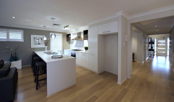 Altona kitchen design, on display at Chisholm #islandbench #whitekitchen #breakfastbar #kitchen