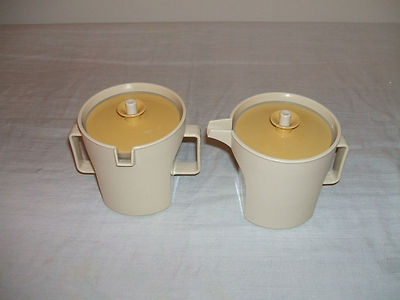 VINTAGE TUPPERWARE CREAM & SUGAR SERVERS BEIGE WITH GOLD LIDS EXCELLENT SHAPE...just threw mine out..didnt know they were considered vintage