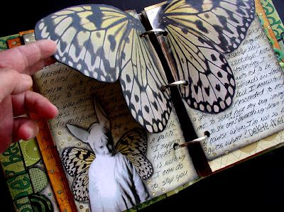 butterfly - Ingrid Dijkers - love the way the butterfly wings are added as pages in this mini album!
