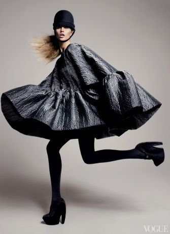 pose///Balenciaga by Nicolas Ghesquière   Photographed by David Sims for Vogue.  The movement of the model is a great way to show off the voluminous nature of the garment and just how full the dress is.  Her legs show this movement and angular positioning fill up the bottom of frame.