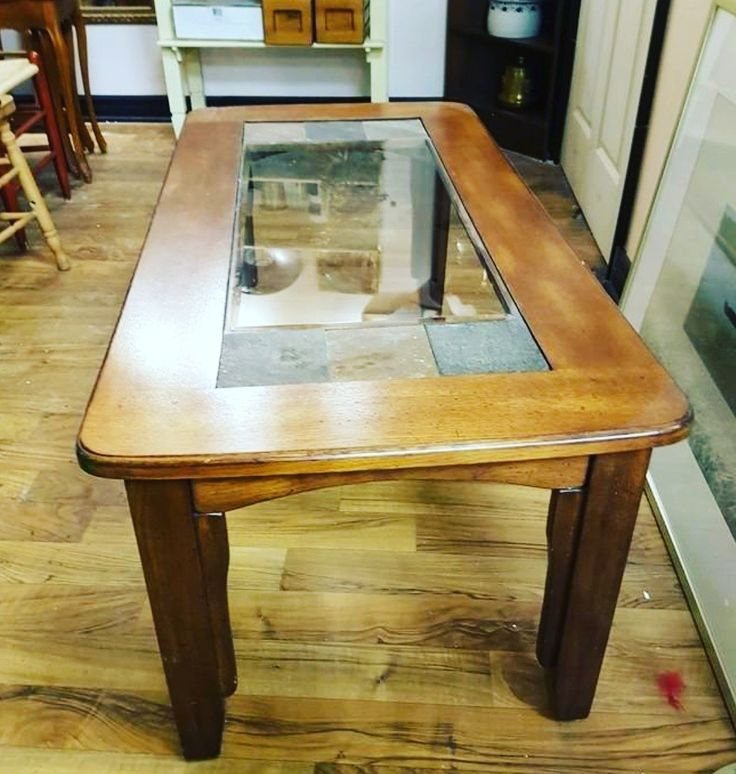 Stunning coffee table, glass and slate. Register today to big for this piece in our current online auction https://auction.blackpearlemporium.ca/m/#/auction/19/item/wood-glass-slate-coffee-table-192 #collingwood #auctions #furniture #giftideas