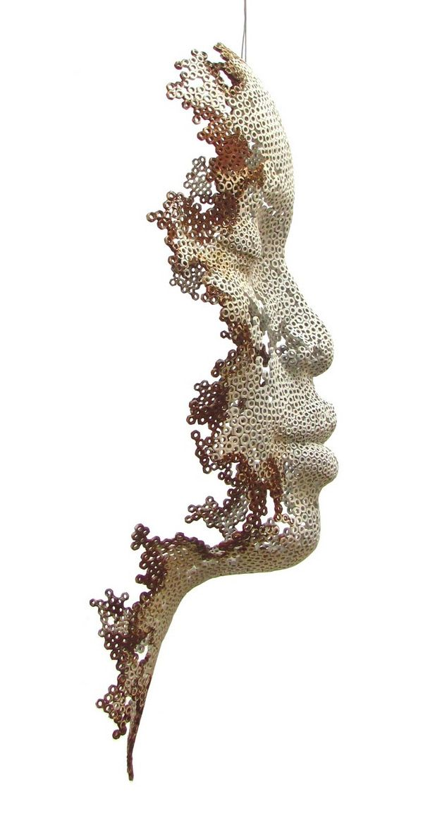 Fading Human Sculptures Made of Iron Nuts - My Modern Met