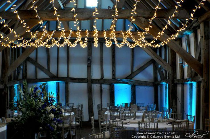 Blue uplighting with a fairy light  canopy for a lovely barn wedding