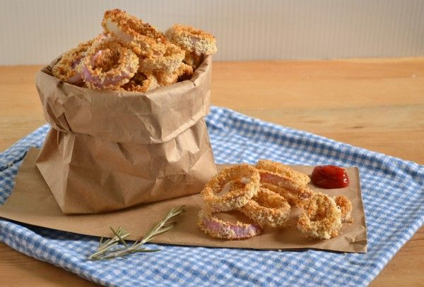 BAKED ROSEMARY ONION RINGS Serves 4-6        1/4C whole wheat flour      2 tsp paprika      2 tsp salt      1 tbsp very finely chopped fresh rosemary      2 eggs well beaten      2-3C panko or whole grain bread crumbs      2-3 medium sized onions(we've used red onions or yellow onions, both work fine.  Choose a milder/sweeter onion for those that don't want them to be overly oniony)