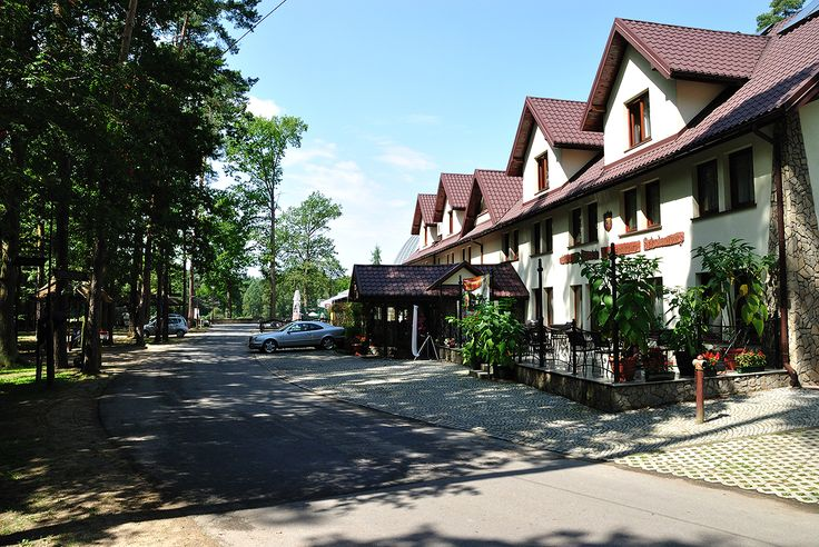 Grand Hotel in a woods area.  Hotel *** in a recreation resort, in a forest.