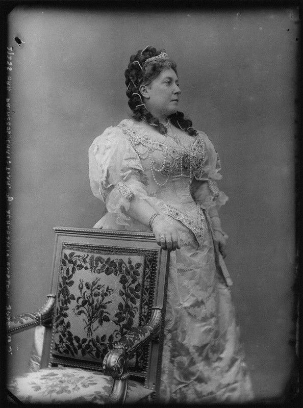 Victoria and Albert's next daughter, Princess Helena, seen  here in her glad rags for the Devonshire House Ball of 1897. She's wearing a diamond tiara with a large, dark central gem stone, it could be the 'real thing' or possibly something made especially for the Ball