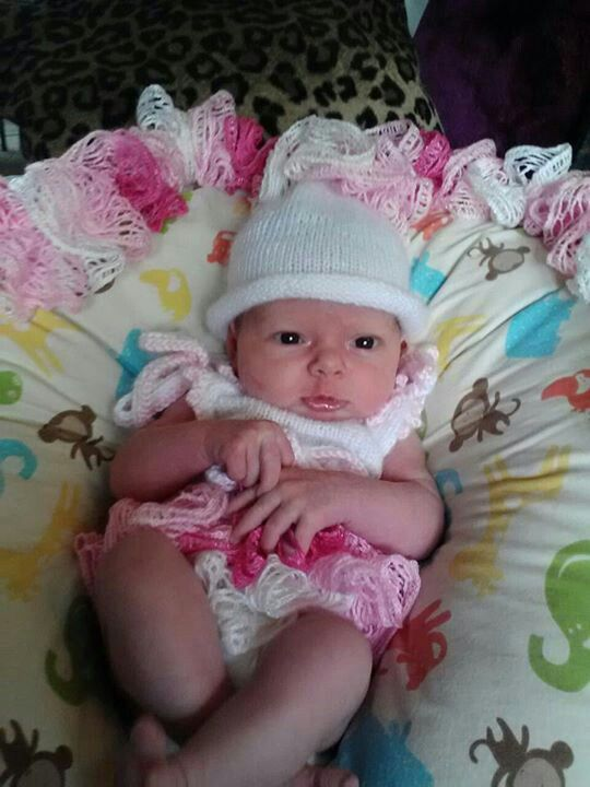 Dress & hat I designed for my granddaughter. The dress has Sashay yarn around it from the waist down.