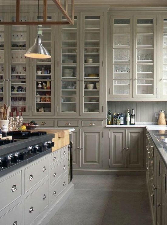 Unbelievable amount of cupboard and drawer units in this kitchen, love the full length cabinets with glass panels. To top it off the pulls look stunning against the grey/green coloured panels