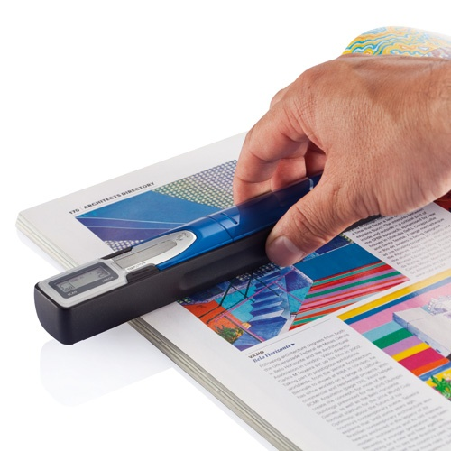 Portable scanner. Portable scanner supports micro SD card up to 32 Gb (card  excluded). This scanner can save and convert documents or  photo's into digital format files and recognizes text.
