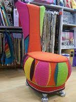 Fauteuil de marque Bretz , relooker en couleurs  en huit coloris et en deux matières tissu  souligné de nervure sur...