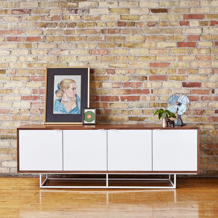 Emerson Credenza | The Emerson Credenza is a minimalist design that contrasts wood grain with smooth lacquer surfaces, creating a piece that is both timeless and contemporary. | Gus* Modern