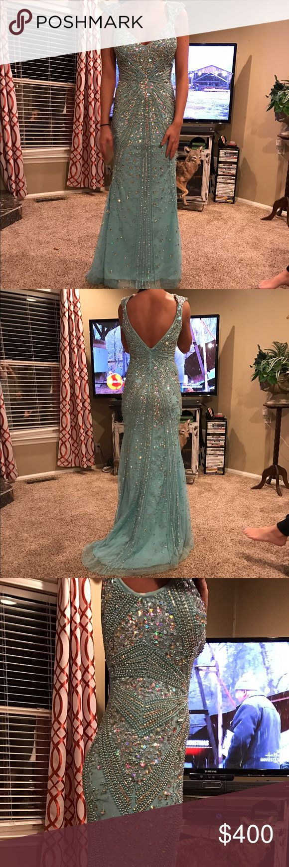 Beautiful prom dress for sale!!! Size 4 Tiffany & Co. prom dress. Has been altered to my height (5'4). It has a long beautiful train on it with stunning beads. Only worn once for about 5 hours. Bought it original at $800. To rent, $275 but can be negotiated. To buy, $400 but can be REASONABLY negotiated because this dress is so expensive. Tiffany & Co. Dresses Prom