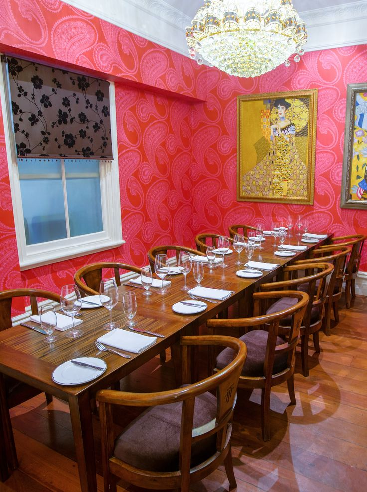 The Red Dining Room - So named for its luxurious ruby red wallpaper, the room also features a chandelier and fireplace.