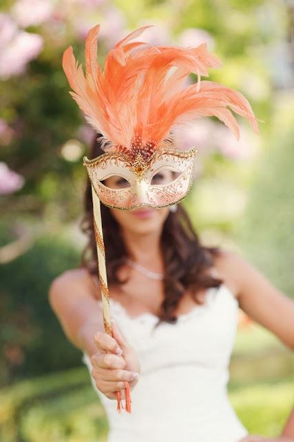 Masquerade masks are a cool, classy prop idea...
