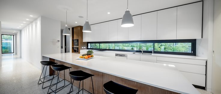 Modern architecture, kitchen, window splash back.  By Collins Caddaye Architects, Canberra.  Photographed by Stefan Postles, Chalk Studio.