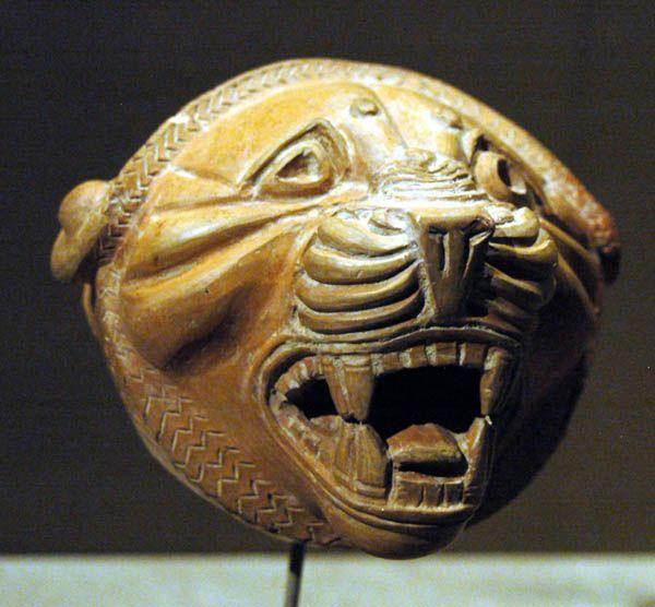 lion rhyton | Fragment of Lion Head Rhyton in buff burnished ware. From Western Iran