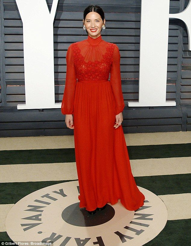 Red on red: The actress accessorized with a tiny red purse, and color coordinated in a bold red lip