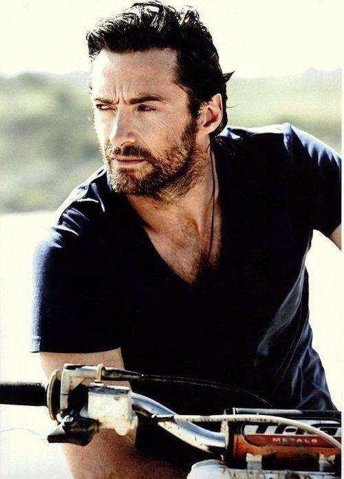 black stubble, black chest, black self esteem in black T-shirt