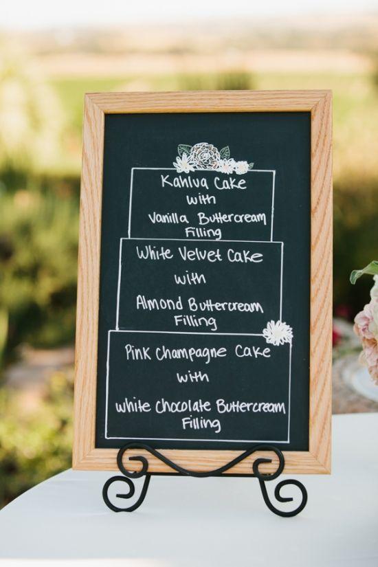 chalkboard with cake flavors #cakeflavors #diy #weddingchicks http://www.weddingchicks.com/2014/02/28/soft-summer-vineyard-wedding/