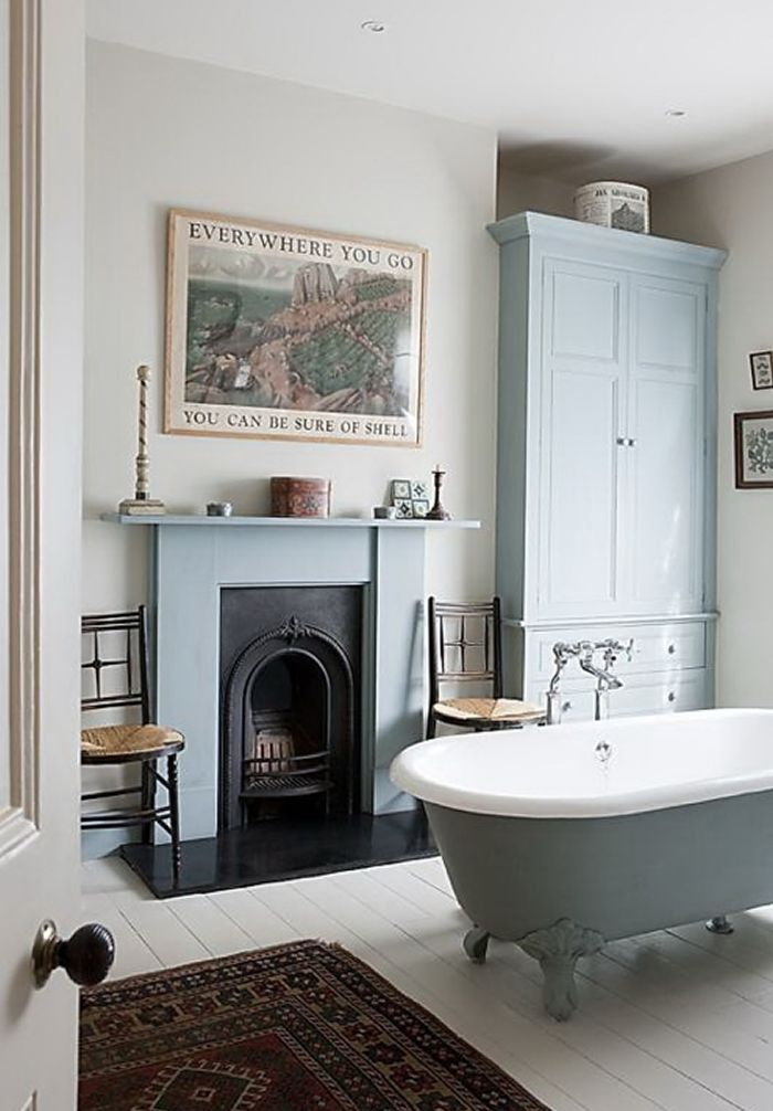Classic Period Bathroom. I don't know what I love more... the roll top bath, the fireplace, the colour...
