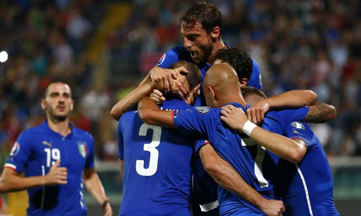 Italy\'s Chiellini celebrates with teammates after scoring against Azerbaijan during their Euro 2016 qualification soccer match in Palermo