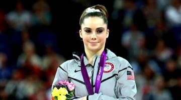 In a lawsuit filed Wednesday, the Olympian said she signed a non-disclosure agreement after going to the USA Gymnastics organization to seek financial help for psychological treatments. USA Gymnastics says that's true.