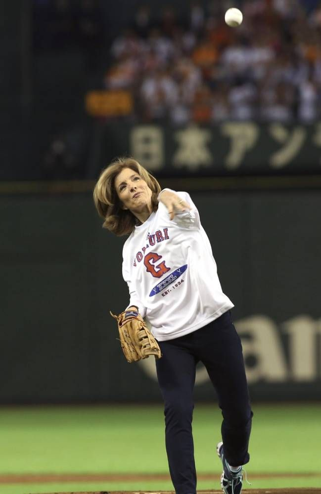 U.S. Ambassador to Japan Caroline Kennedy throws out the ceremonial first pitch before the Japan's Central League professional baseball opening game between the Yomiuri Giants and the Hanshin Tigers at Tokyo Dome in Tokyo, Friday, March 28, 2014. (AP Photo/Eugene Hoshiko)