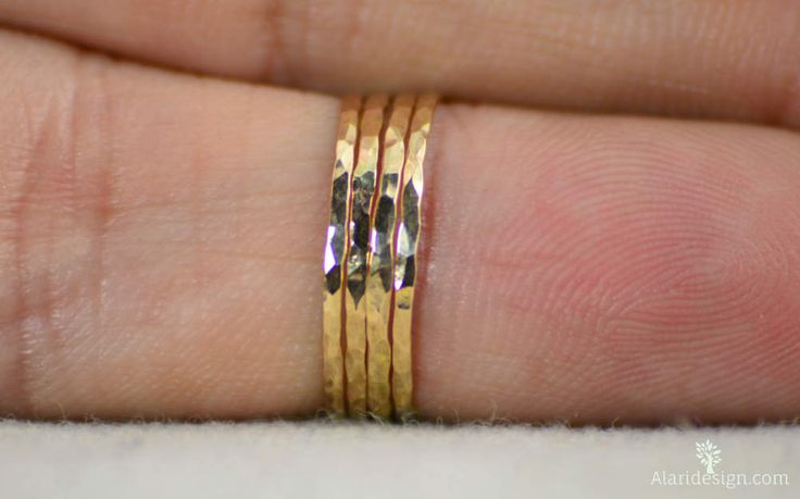 **Free Domestic Shipping for all orders over $50! Use Coupon Code: SHIPFREE50.**  Super Thin 14k Gold Filled Stacking Ring(s):  These rings are $8 each. Choose the number you want from the Quantity pull-down.  Rich and elegant glowing gold filled bands. Rustic, understated luxury. - Delicate hand hammered strands of gold. - These rings look best when worn in odd numbers: 1,3,5, etc. - Made to order, just for you. - Mailed in a cute package suitable for gifting.  Each ring is made with high…