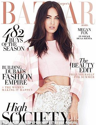 Pretty: Megan appear's on the cover of the new image of Harper's Bazaar in a pretty pink c...