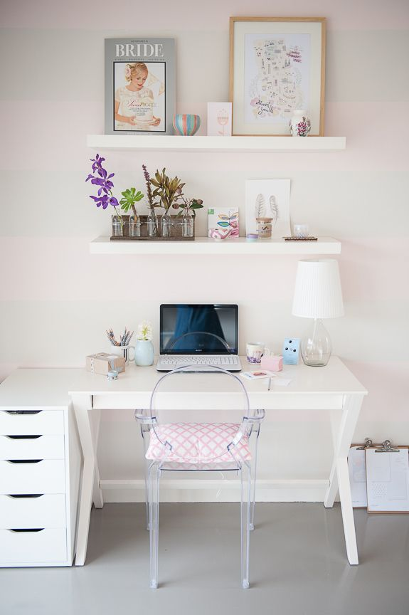 small desk with file next to it