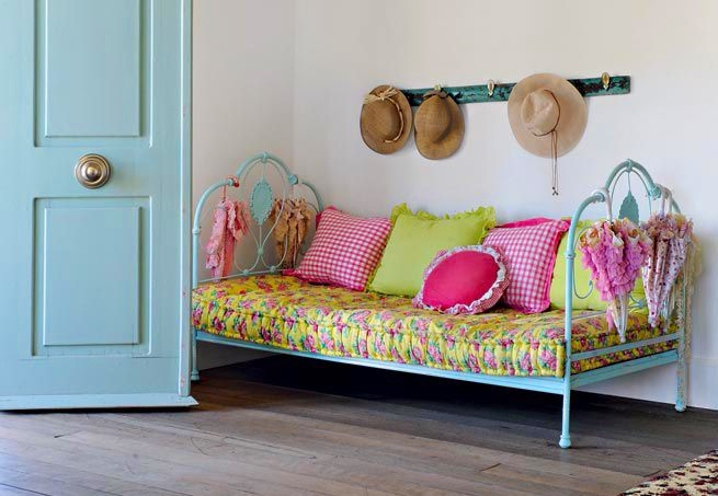Paint an old iron bed... use it as a sofa!!! Makes a country home decor idea!!!