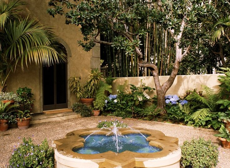 front yard fountains flower pots doube doors pavers walls plants mediterranean design of Beautiful Front Yard Fountains to be Greatly Amazed By