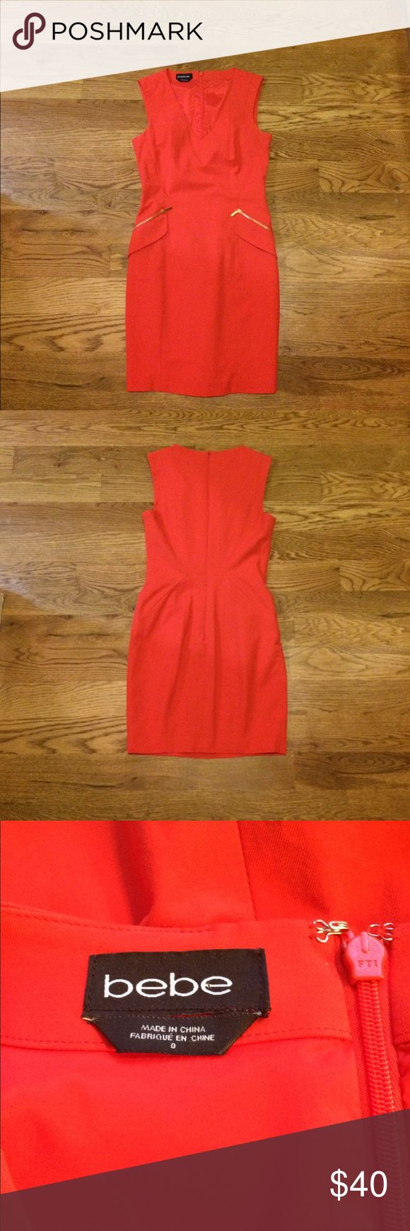 ♦️♦️Coral Red Bebe Dress♦️♦️ Form fitting dress, with gold zippers on bodice...one slight area of wear on back of dress bebe Dresses Mini