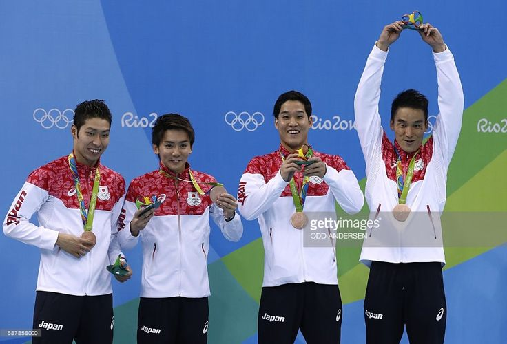 Japan's Kosuke Hagino, Japan's Naito Ehara, Japan's Yuki Kobori and Japan's Takeshi Matsuda pose with their bronze medal on the podium of the Men's 4x200m Freestyle Relay Final during the swimming event at the Rio 2016 Olympic Games at the Olympic Aquatics Stadium in Rio de Janeiro on August 9, 2016. / AFP / Odd ANDERSEN