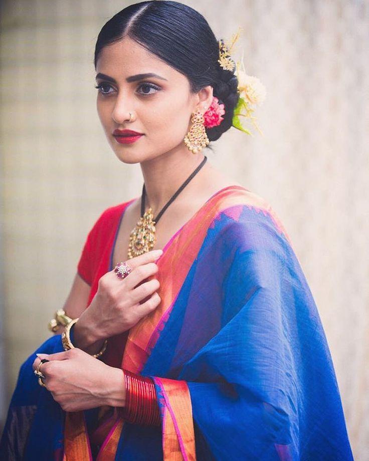 South Indian bride. Gold Indian bridal jewelry.Temple jewelry. Jhumkis. Simple blue silk kanchipuram sari.Bun with fresh jasmine flowers. Tamil bride. Telugu bride. Kannada bride. Hindu bride. Malayalee bride.Kerala bride.South Indian wedding. Bhargavi Kunam.